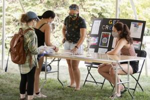 Students at club fair looking at information