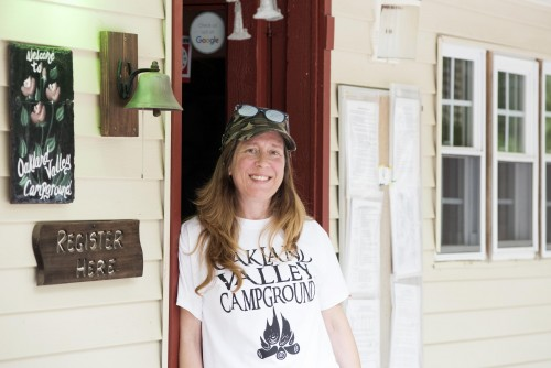 Woman standing in door of campground welcome station