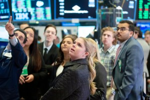 Students looking at board at New York Stock Exchange