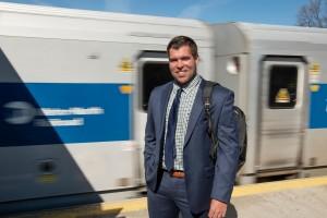 MSMC Grad Blake Keenan stands on train platform