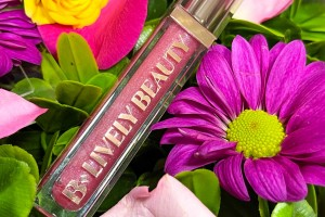 B-Lively lip gloss placed on top of flowers