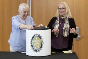 Susan LaRocco and Kathleen Pecoraro sealing the Mount Nursing School time capsule.