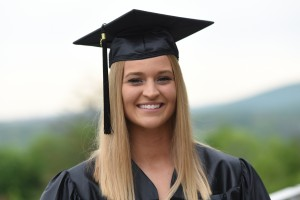 Headshot of Hanna Sheppard in graduation cap