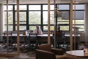 Mount business professor sits with student in new School of Business wing