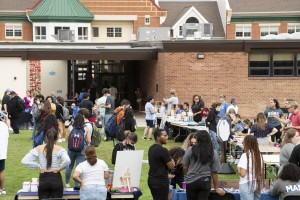 Students gathered outside at the Mount Saint Mary College Club Fair.