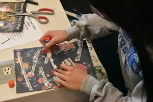 Student creating a haiku out of newspaper clippings.