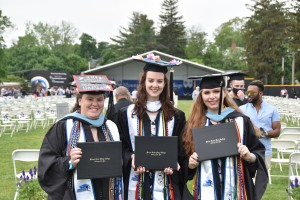 Sophia Reinhardt, Shayla McCarroll, and Daley O'Keefe photographed in their caps and gowns.