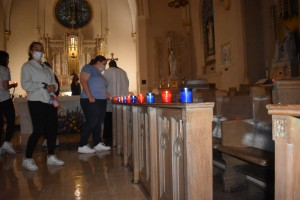 Students walking up to light candles in The Chapel of the Most Holy Rosary.