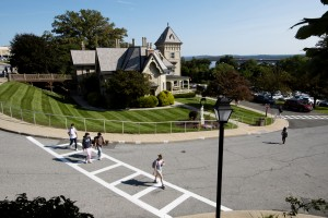 Students walking through Mount Saint Mary College campus with the Villa building in the background.