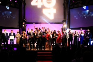 Recipients of the Forty Under 40 Mover and Shaker award standing together on stage.