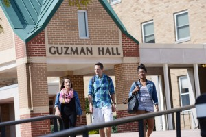 Mount Saint Mary College students walking outside of Guzman Hall, where the Community Engagement and Wellness Center will be located.