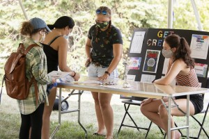 Mount students attend socially distanced club fair outside.