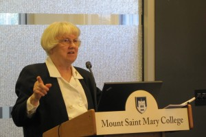 """Sister Cecilia Murray photographed giving a lecture."""