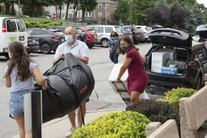 Mount student and family members move into residence hall.