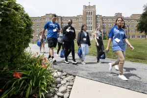 Students walking through the Mount's campus at orientation.