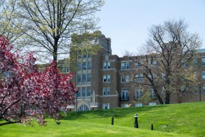 """Mount Saint Mary College's Dominican Center behind spring blooms"""