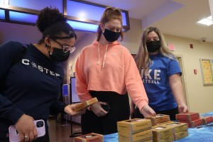 Three Mount Saint Mary students choosing their individually wrapped pies in celebration of the upcoming Pi Day. Choices included lemon, pecan, and cherry.