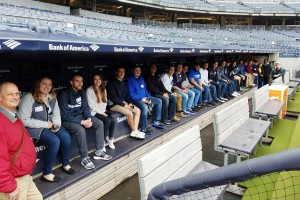 Scott Russell sitting in a dug-out at Yankee Stadium with his Business students.
