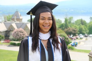 Cyan Scott photographed in her cap and gown at graduation.
