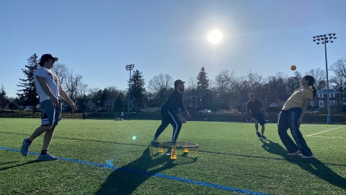 Students playing spikeball