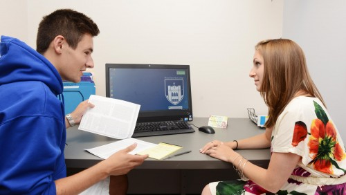Writing Center tutor reviews paper with student
