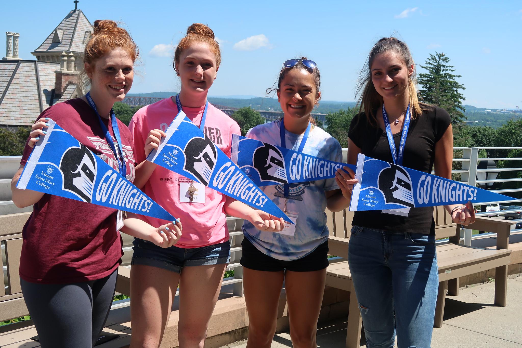Students posing with pennants