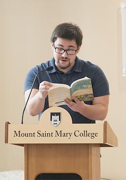 Student reading at podium