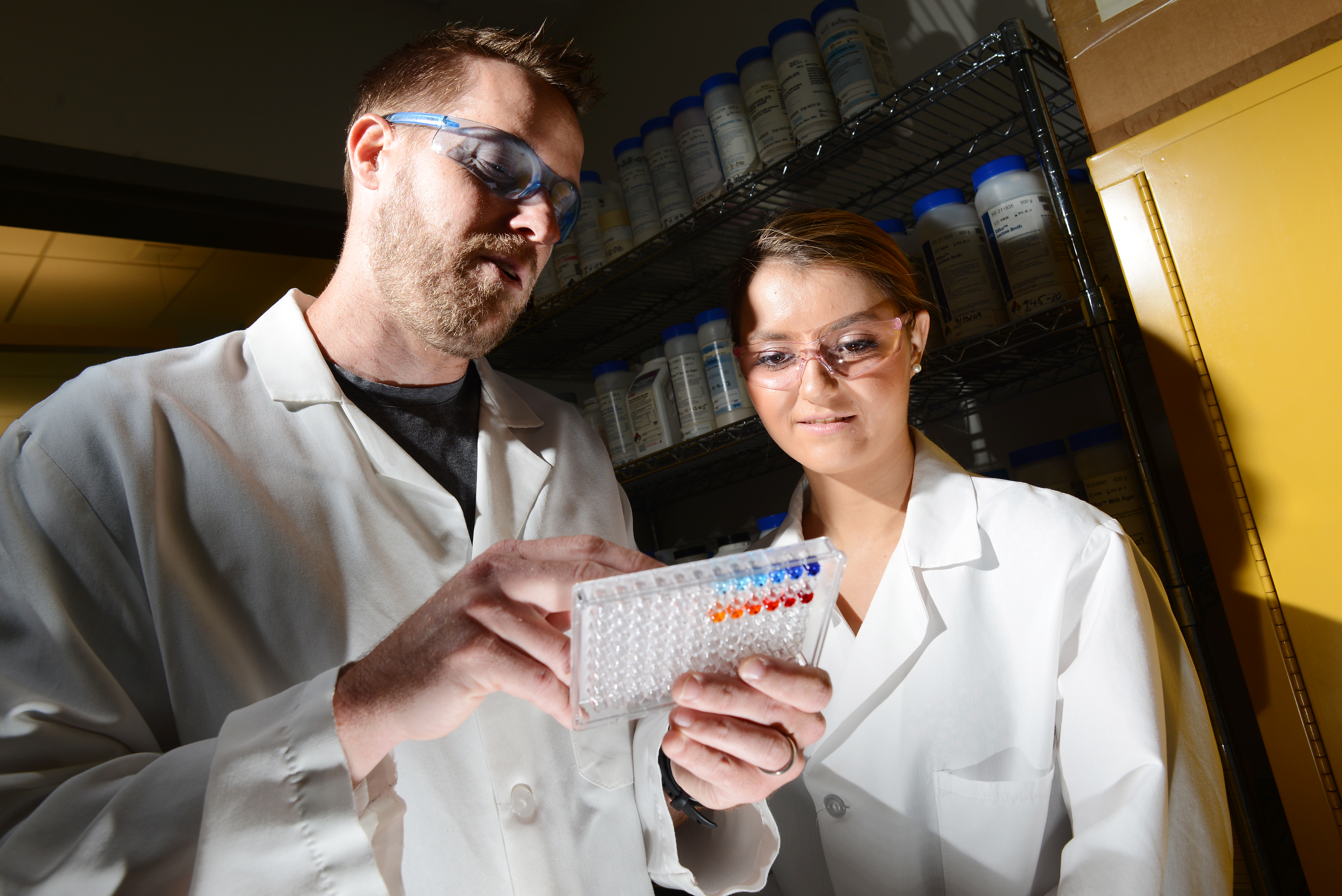 Professor and student looking at chemical material