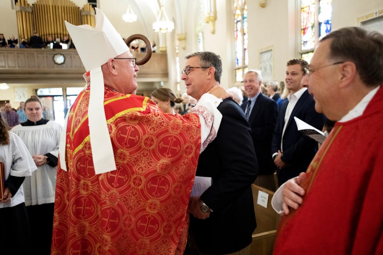 Cardinal Timothy Dolan, archbishop of New York, greets Dr. Adsit at the Inauguration