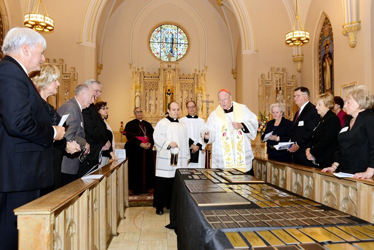 Cardinal Timothy Dolan blesses plaques bearing the names of the Dominican Center's benefactors