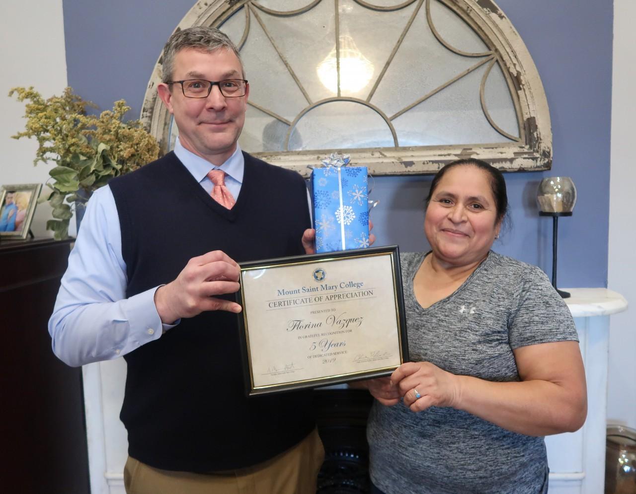 Florina Vazquez (Facilities) and Dr. Jason Adsit, president of the Mount