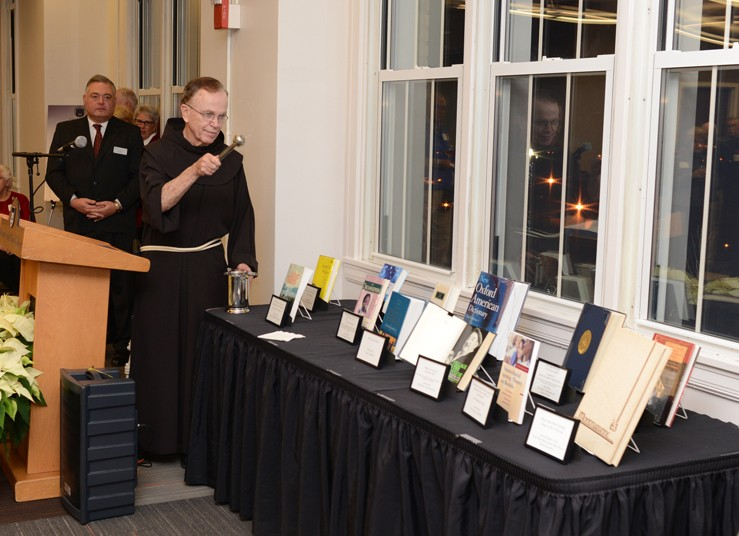 Fr. Kevin E. Mackin, OFM, recently blessed the first dozen books placed in the Dominican Center's new library