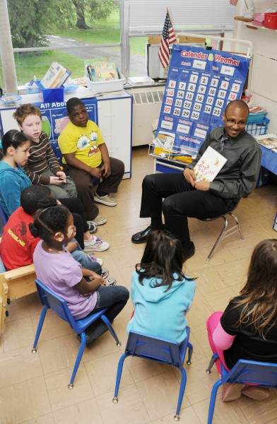 Teacher reading in circle to students