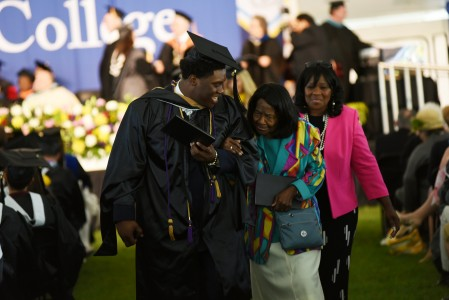 Student walking with family at Commencement