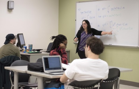 Teacher teaching math class