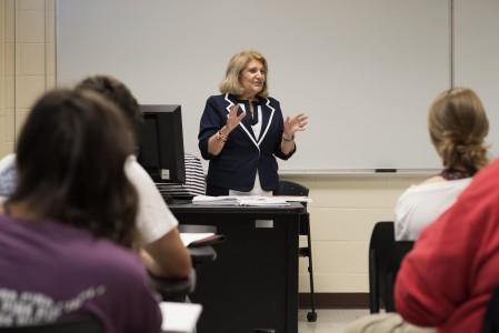 Professor teaching at head of classroom