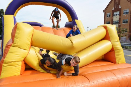 Student playing on inflatables