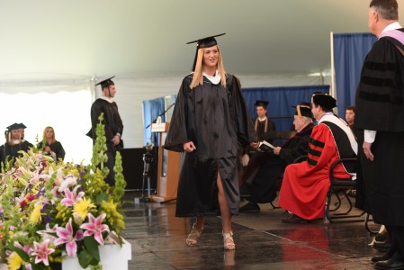 Hanna Sheppard walking across the stage at Mount Saint Mary College's spring 2016 commencement ceremony