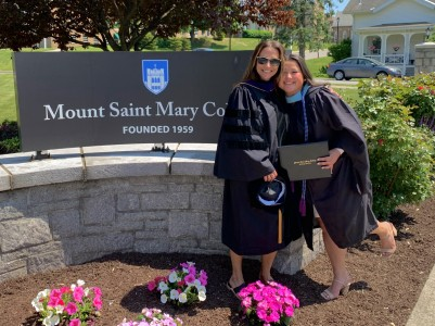 Jenna Park and Tiffany Gagliano photographed standing next to the Mount Saint Mary College entrance sign.