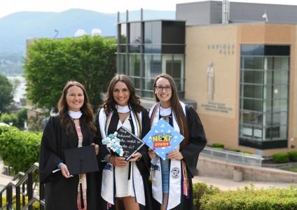 Olivia Pelliccia, Nicole Cervone, and Renee Hydo holding their graduation caps.