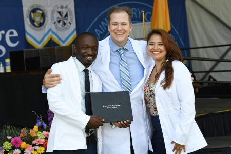 Three nursing graduates standing together at the May 2021 pinning ceremony.