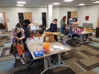 Medici Scholars assembling swag bags for Safe Harbor of the Hudson
